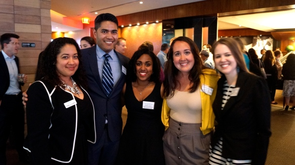 At left, Johnelle joins members of the Young Professionals @ IH board of directors at a networking event.